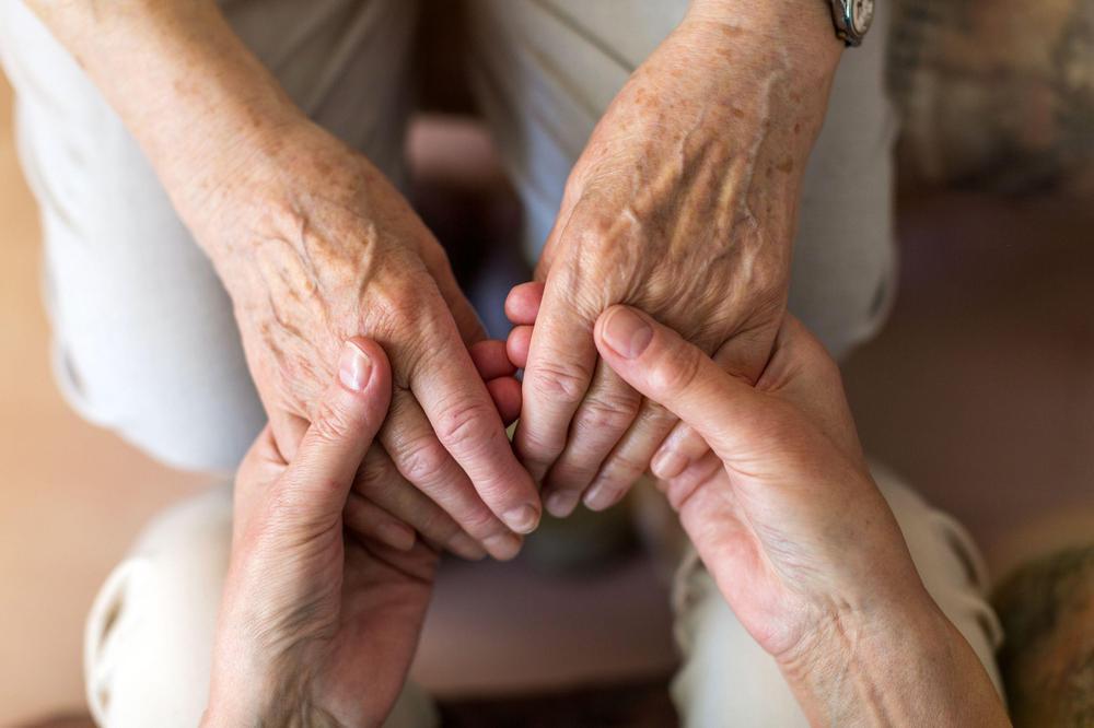 bigstock-nurse-consoling-her-elderly-pa-298175911